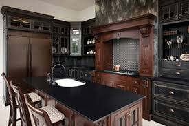 furniture black corian countertop with arch faucet and stools