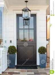 black front door framed by plants stock photo image 39177050