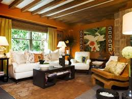 tropical themed living room warm color scheme for tropical themed living room with white sofa
