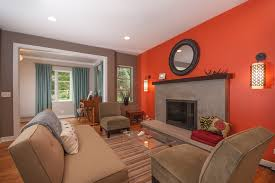 what color goes with orange walls orange living room accent wall home design game hay us