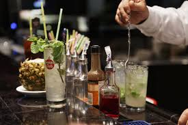 alcoholic drinks at a bar essential liquors and mixers to stock in your home bar