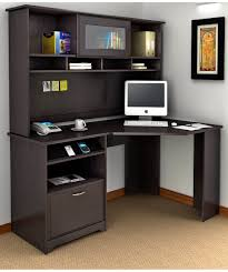 black wooden corner desk with drawers and shelves on brown rug