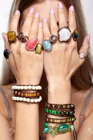 stones finger rings images Young woman hands with multiple bracelets and fingers with many jpg