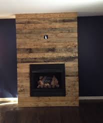 how to create a diy reclaimed wood fireplace surround for less
