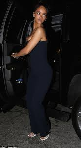 rihanna jumpsuit rihanna flashes plenty of cleavage in a jumpsuit after the grammy