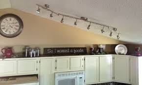 space above kitchen cabinets excellent how to decorate small
