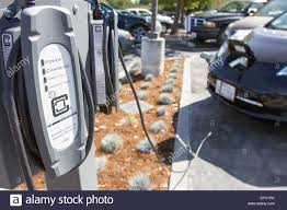 electric vehicles charging stations ev charging stations with plug in electric car plugged in to