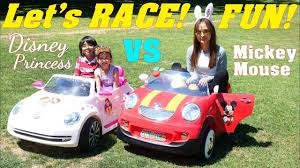 frozen power wheels sleigh ride on power wheels racing car race disney mickey mouse versus