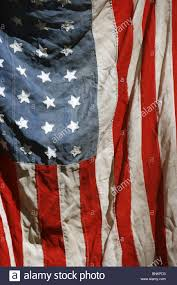 Flag Hanging One Old American Flag Hanging On Wall Outside In Sun Stock Photo
