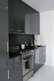 contemporary black kitchen cabinets glossy black kitchen cabinets with black marble herringbone