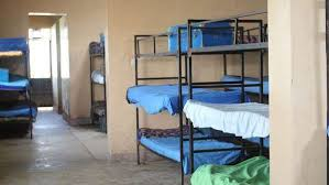 Dormitory Bunk Beds Bunk Beds Sit Empty In A Room In A Kenya School Stock