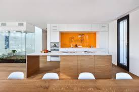 Cream Kitchen Cabinets With Black Countertops Cream Wooden Kitchen Cabinet And Island With Black Countertop Plus