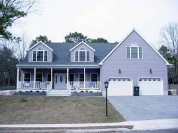 Two Car Garage Plans by Cape Cod Style Home With Farmers Porch Two Car Garage And Large