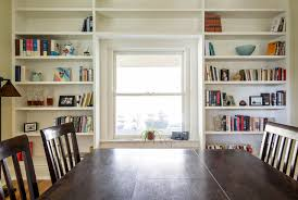 bookshelves in dining room wall of bookshelves traditional dining room louisville by