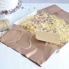 gift box tissue paper gift box tag gold thread tissue paper and petals by the letter