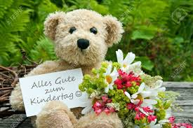 s day teddy teddy with flowers and children s day card stock photo picture