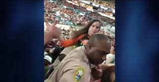 miami fan slaps officer watch belligerent fan slaps officer while being carried out o