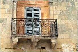 wrought iron balcony old property that needs to be restore