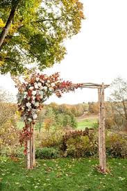 wedding arch leaves picture of wooden arch with a corner decorated with fall leaves