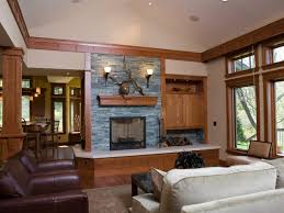 this stone fireplace is bordered by wood trim and accented with a