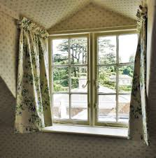 cute dormer window dressed with interlined curtains and dormer