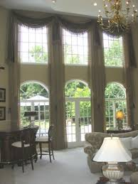 Hanging Curtains From Ceiling To Floor by Silver Metallic Curtains Double Height Modern Architecture