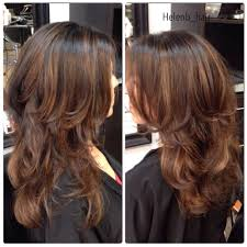 a balayage done with caramel u0026 chocolate pops of color followed by