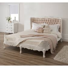 wondrous white finished wooden king size upholstered tufted bed