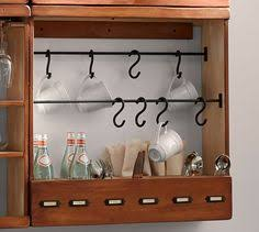 Pottery Barn Shelf With Hooks With Our Owen Entryway Cabinet You Get The Finely Finished Look