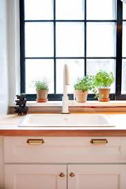 kitchen sink cabinet sponge holder how to install a sink tip out tray for storage the of