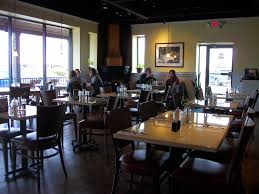 sweet clove sunshine cafe columbus oh the inside of the cafe is a modern country decor bright and sunny colors adorn the walls which are accented by the hardwood floors and a brick