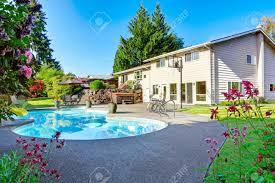 backyard with small beautiful swimming pool tub patio area