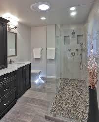 pebble shower floor bathroom transitional with bath storage black