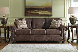 Living Room With Black Leather Furniture by Faux Leather Sofa With Rolled Arms And Nailhead Trim By Benchcraft