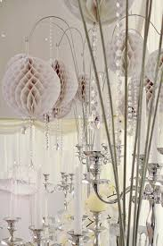 white honeycomb paper decorations with crystal droplets hanging