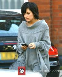 lily allen leaves her house wearing ugg boots and a long grey