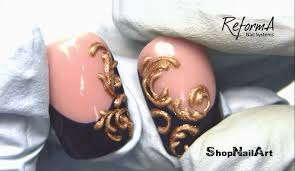 golden baroque ornament 3d nail featuring reforma gel paint