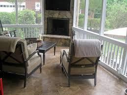 travertine tile screen porch with stone outdoor fireplace for