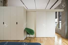 modern style bedroom interior with room divider separating it