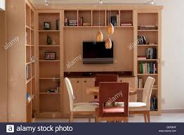 interior of an open den or game room featuring bookshelves a