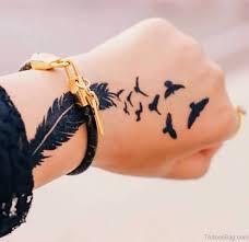 43 fancy birds tattoos on hand