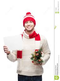 young man holding small christmas tree and sign stock photo