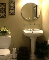 trendy circle mirror over white single pedestal sink also sweet