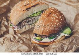 burger wrapping paper green vegetables wrapping paper stock images royalty free images