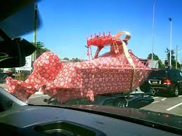 car wrapped in wrapping paper boat in wrapping paper random lifestyle