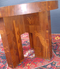 a rare antique marquetry inlaid wooden coffee table with cowboy