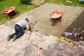 Diy Paver Patio Installation by Young Man Installing Paver Bricks For Large Patio Stock Photo