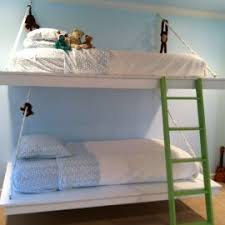 foldable bunk bed with black metal bed frame and wooden wear for