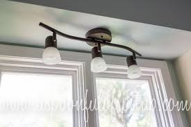 a spoonful of spit up kitchen project 2 diy mason jar light fixture and then i went to menard s for the first time and found some 22 track lighting so now we have it above the sink and it s much better