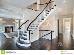 foyer with curved staircase stock photo image 13028850